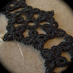 This bracelet is made up of three motifs created using a vintage pattern and tatted together. I hand needle tatted the piece in high quality black cotton thread and it closes with two simple hooks that attach directly to the lace.    The bracelet measures 6.5(16.5cm) long and has a bit of natural stretch.    This piece can also be created in any thread color available on my policy page. Simply convo me with any request you might have.
