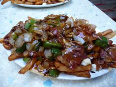 To be clear, adding ingredients to poutine can be okay — IF you've earned it. poutine from La Banquise in Montreal has bacon, grilled onions and peppers http://www.buzzfeed.com/henrygoldman/why-cant-americans-get-poutine-right
