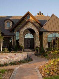really like the stonework use of arch and variations in facing view brick ranch home exteriors - Luxury Homes Exterior Brick