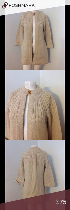 Vintage Wool Long Swing Sweater S Beautiful vintage sweater! Longer style with a flared bottom. Button closure at the neckline with side pockets. Great condition! 95% wool in size Small. Vintage Sweaters Cardigans