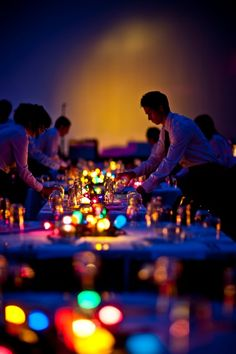 Great example of how colorful LED lights really *pop* when a party room is dimly lit. Lovely for wedding receptions and big corporate events. Get the look with these bright, long-lasting and inexpensive submersibles: http://www.flashingblinkylights.com/ledsubmersiblecraftlights-c-114_462.html