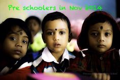 Pre-schoolers in Nov 2014. From Jan 2015, these children will be part of regular schooling. They will enter the Nursery class. It's a joy to watch such small children enjoying their first experience of school. Though here they are looking at the lens with wondrous eyes, they are usually enthusiastic about getting their pictures taken Lens, Nursery, Classroom, Joy, Watch, School, Children, Pictures, Class Room