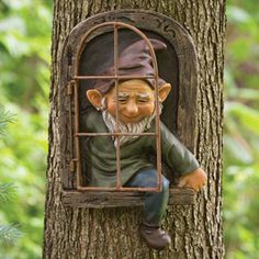 Elf Out The Door Tree Hugger - Garden Peeker Yard Art - Whimsical Tree Sculpture Garden Decoration. Hang this cute little elf on your tree or fence and he appears to be climbing out of a wooden window. Fairy Doors On Trees, Fairy Tree Houses, Fairy Garden Doors, Fairy Garden Houses, Gnome Garden, Diy Fairy Door, Fairy Garden Ornaments, Fairy Gardening, Garden Angels