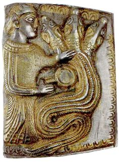 Another Letnitsa plaque showing a woman with mirror conjuring a dragon with three wolf-heads. Thracian treasure