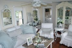 """""""I love everything white-on-white and texture. We wanted a feeling of all white and used soft blue to bring the ocean in. The matching French chandeliers on the wall were imported from Paris. There are a total of six chandeliers in this little one-bedroom bungalow. You can never have too many."""" � Susie Holt"""