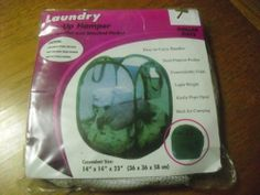 """Laundry Pop up Hamper with Handles and Attached Pocket by laundry by SHELLI SEGAL. $3.00. Dual purpose pocket. ideal for camping. light weight. Easy to carry handles. conveniently folds. Laundry pop up hamper with handles and attached pocket. Easy to Carry handles and dual purpose pocket. 14"""" x 14"""" x 23"""" (36 x 36 x 58 cm)"""