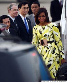 Michelle Obama Arrives in Japan in Vibrant Kenzo Dress