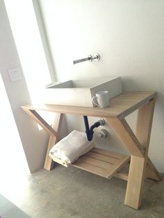 """""""A couple years ago while remodeling our home I designed and built this concrete sink and wood table. The idea of not having a mirror to look into was an experiment to bring one into the present..."""""""
