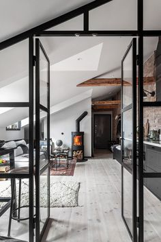 An Industrial Look For A Small Attic Apartment in Stockholm — THE NORDROOM - - New York vibes in a small Scandinavian attic apartment with exposed brick walls and industrial elements. London Apartment, Attic Apartment, Attic Rooms, Attic Spaces, Home Design, Home Interior Design, Interior Decorating, Appartement Design, Small Attics