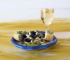 Pasta with mussles in Buttery Garlic Sauce, Garlic Bread, and Wine by OneSixthSense