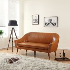 This Modern Mid-Century Style sofa features soft durable bonded leather. A very comfortable and original style couch that provides you with a unique and contemporary look. This curved shaped sofa is a...