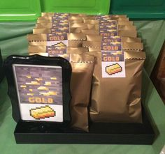 Gold favor bags at a Minecraft birthday party! See more party planning ideas at CatchMyParty.com!