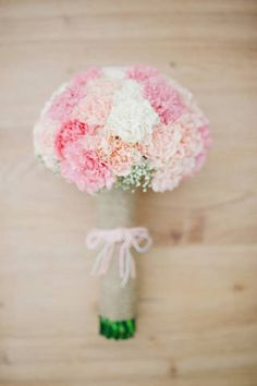 Carnations in blush, peach, and white were used for the bridal bouquet | www.BridalBook.ph