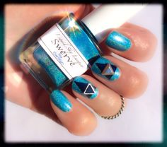 """Different angles. Zoya """"Indigo"""" and some studs add a geometric flare to Liquid Sky Lacquer """"Swerve."""" Holographic. Triangle nail studs. #nails"""
