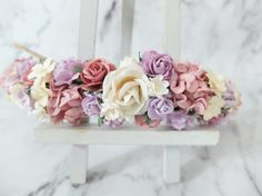This flower crown is a mix of many kinds of flowers. The colours used are dusty pink, lilac, and cream. -------------------------  MATERIAL: mulberry