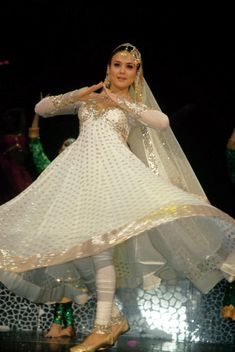 Bollywood Actress Preity Zinta in Designer White Anarkali SuitPreity Zinta in anarkali suit was looking fabulous. A designer white salwar suit made her look perfect for dancing appearance. White an...