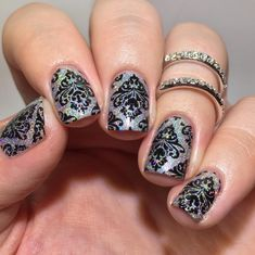 Holo Nail art @wnac_tkc #wnac2015 theme was damask... used @orlynails Mirrorball as the base stamped…