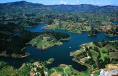 View of Guatape Lake from high above in Colombia Visit Colombia, Family Holiday Destinations, Spanish Speaking Countries, Booking Sites, Tourist Spots, How To Speak Spanish, Travel Goals, Tourism, Guatape