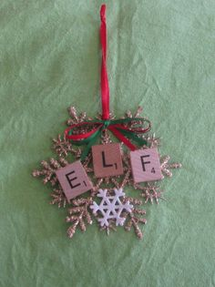 ELF Christmas ornament in scrabble tiles on a 4 inch gold glitter snowflake accented with a smaller white snowflake. Finished with a red and green bow and red ribbon for hanging. Scrabble Ornaments Diy, Scrabble Letter Crafts, Puzzle Crafts, Letter Ornaments, Scrabble Tiles, Snowflake Ornaments, Easy Ornaments, Scrabble Letters, Shell Ornaments