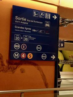 Sign at Gare du Nord, Paris France. J Chung. There are many different ways of getting into Paris from Charles de Gaulle (CDG) airport, but the cheapest way isn't always the best way. http://www.francetraveltips.com/charles-de-gaulle-airport-to-paris-cheaper-isnt-better/