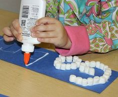Winter Crafts for Kids - Marshmallow Name Writing Activity. Help your kids with their fine motor skills with this educational writing activity. All you need is paper, marshmallows, and Elmer's glue! Marshmallow Activities, Name Activities Preschool, Marshmallow Crafts, Kids Learning Activities, Preschool Activities, Preschool Sign In Ideas, Preschool Projects, Preschool Curriculum, Learning Letters