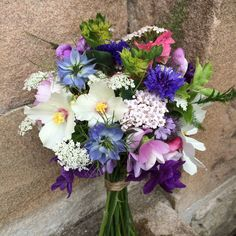 Summer flowers full of nigella, philadelphus mock orange, achillea, buplereum, ammi majus, sweet peas and salvia