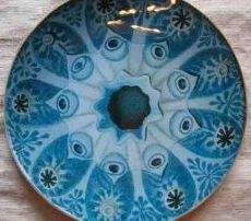 Mary Yanke from the USA uses Transferglaze in her work.  She creates intricate designs principally on glass plates and trays.