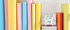 Schnell und einfach: Schulbücher in buntes Papier einbinden