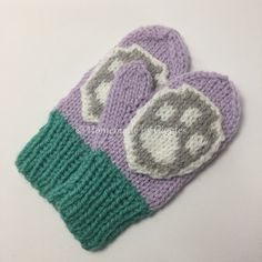 Knit Paw Patrol Inspired Mittens – Homemade by Giggles.  Link to free knit pattern and pixel chart for paw patrol patch.  Made with Everest colors but could be easily changed to Chase, Rubble, Rocky, Zuma, Skye, Marshall or Tracker.