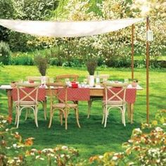 Perk Up a Picnic: Easy Canopy   Drape fabric between four poles sunk in the ground for a DIY sunshade. Use tent pins to anchor lines that run from the pole tops to the lawn.