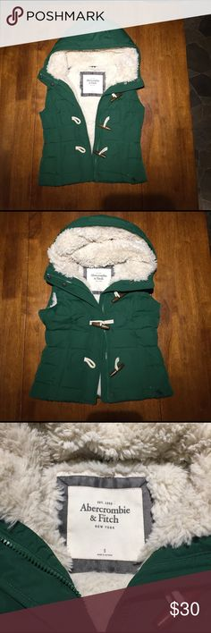 Abercrombie & Fitch Women's Fleece and Down Vest Zippers snaps and toggles. Front pockets. Super cozy. Abercrombie & Fitch Jackets & Coats Vests