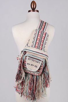 """How adorable is this mini crossbody backpack?? It is fringe perfection! Handmade in India. - Approx measurements. L: 9"""" W: 4"""" (when opened). H: 15"""" - Import"""