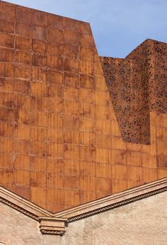 Caixaforum Madrid by Herzog & De Meuron. Cotten. Rusted iron extension to red brick warehouse.