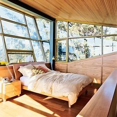 sunny bedroom with tilting factory windows and wood ceiling. I wish for this. I wish for it muchos.