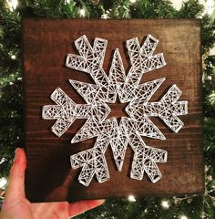 This listing is for a 9.25 x 9.25 string art snowflake! This is shown above with dark walnut stain and white string; however the stain and string color can be customized. The background of the snowflake can also be painted if you prefer that to the stained look! If you would like any custom changes, just send me a message prior to ordering to verify that I can do what you would like :) This sign is so adorable and would be a great addition to your winter decor :)