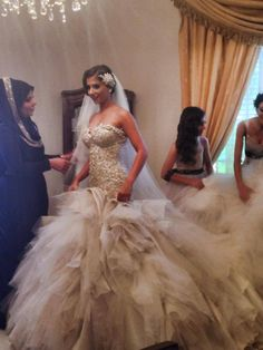 Breathtaking bride Manel in a one off custom Azzaria Haute couture gown & headpiece. Combination of approx 12 different tones & textures of silks & tulles & over 200 meters to create this stunning work of art.