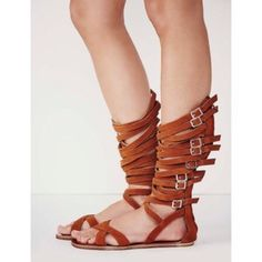 Jeffrey Campbell x Free People 'Romana' Sandal Jeffrey Campbell for Free People 'Romana' sandal in rust.  Like new, only worn twice and have original box and dust bags!  Open toe sandal with criss-crossing straps all the way up. Zipper closure up the back. Eight adjustable buckle closure straps on side.  Perfect for festival season ✌️ Jeffrey Campbell Shoes Sandals