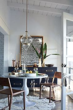 Dining Space with large statement artwork