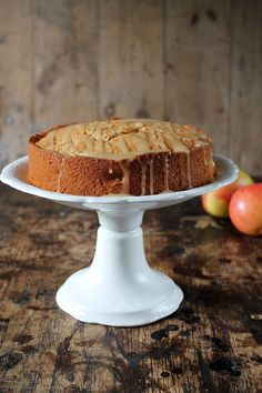This apple cider cake with salted cider caramel drizzle is a moist and decadent treat. It uses boozy hard cider to create an extra-special apple cake! #cidercake #applecake #cider #apples
