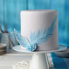 Painted Blue Feather Fondant Cake - Delicate hand-painted touches add elegance to a smooth fondant cake. Use the Wilton Decorating Brush Set and Wilton Icing Colors to paint freehand details for one-of-a-kind works of Creative Cake Decorating, Wilton Cake Decorating, Creative Cakes, Wilton Cakes, Fondant Cakes, Cupcake Cakes, Wilton Icing, Car Cakes, Cake Fondant