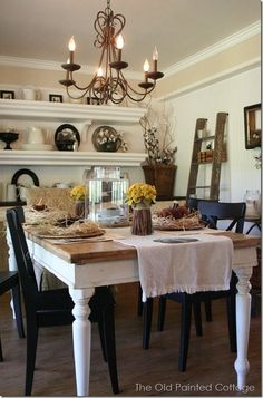 The Old Painted Cottage  Here's a look at our dining room. Using simple materials such as old sheet music for placemats, rattan plate chargers, and velvet pumpkins i...