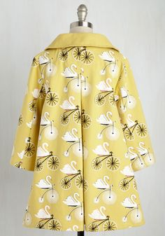 Going, Going, Swan Coat in Dijon. Take a trip to the world of fantastical fashion with this cotton coat, for its whimsy travels far and ride! #yellow #modcloth