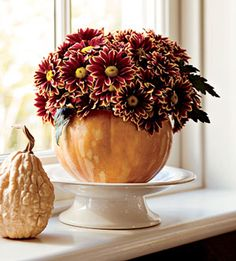 This would be pretty, but I don't know if I have the patience to hollow out the pumpkin.  Maybe I could use one of those fake ones and put a small glass or vase inside for the flowers.