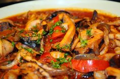 aperture24:    squid casserole with tomatoes and peppers