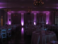 Adding colored up lighting to any wedding event changes from ordinary spectacular. Wedding reception decorations provided by Kims Bridal,