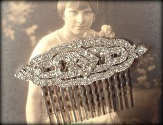 Offering a beautiful bridal hair comb made from an Art Deco vintage style pave rhinestone brooch. A classic Art Deco designed lacy oval silver