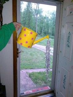 """Yellow watering can """"rain"""""""