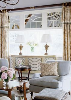 This picture clearly shows another faux / fake transom with fancy trim work - what a difference it make to the window...what an interesting idea for your living room  windows.. creativing faux transoms with mirrors, framed out with the window.  It would certainly help my awkward space!