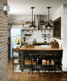 kitchen with exposed brick, wood counter tops, pendant lights, smeg, open shelves