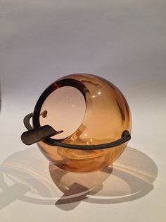 Mid Century (?) spherical amber glass ashtray | Collectors Weekly
